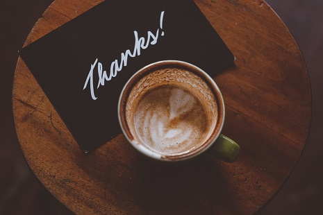 Thank you note and a cup of coffee. Photo by Hanny Naibaho on Unsplash