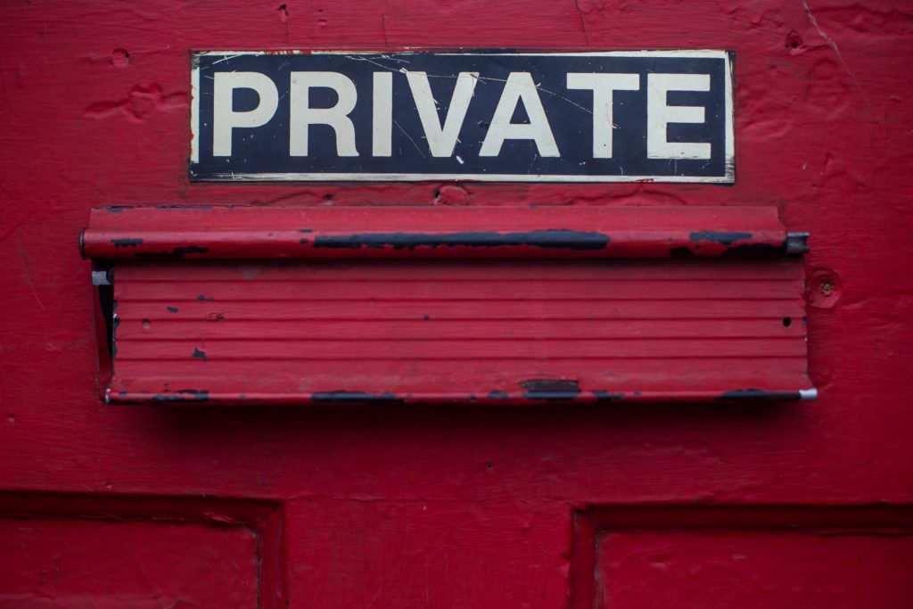 red wall with a sign with the word private