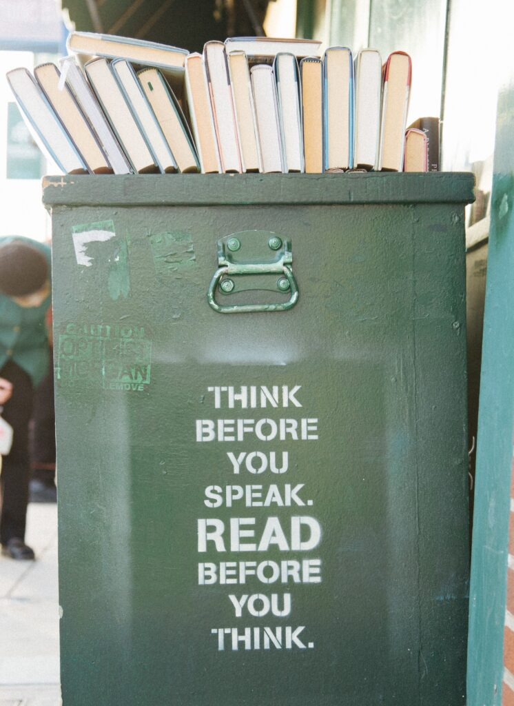 Book bin that says: Think before you speak. Read before you think.