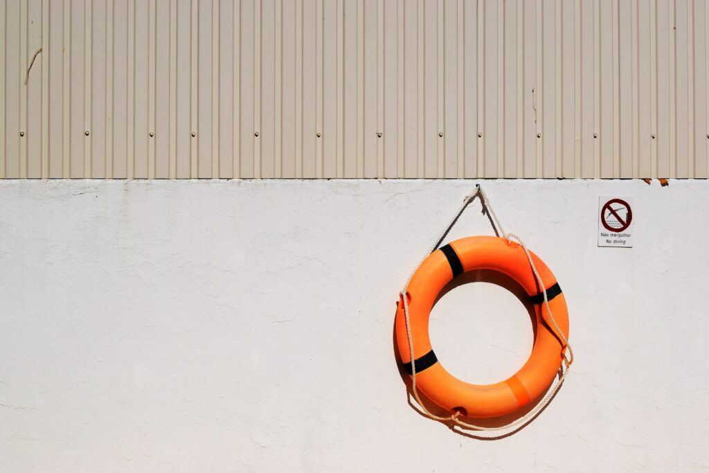 orange life saver ring on a wall